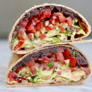 vegan crunchwrap supreme sliced in half