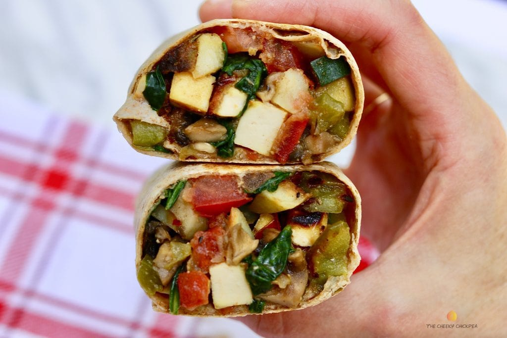 tofu breakfast hash burritos on a red and white dishcloth