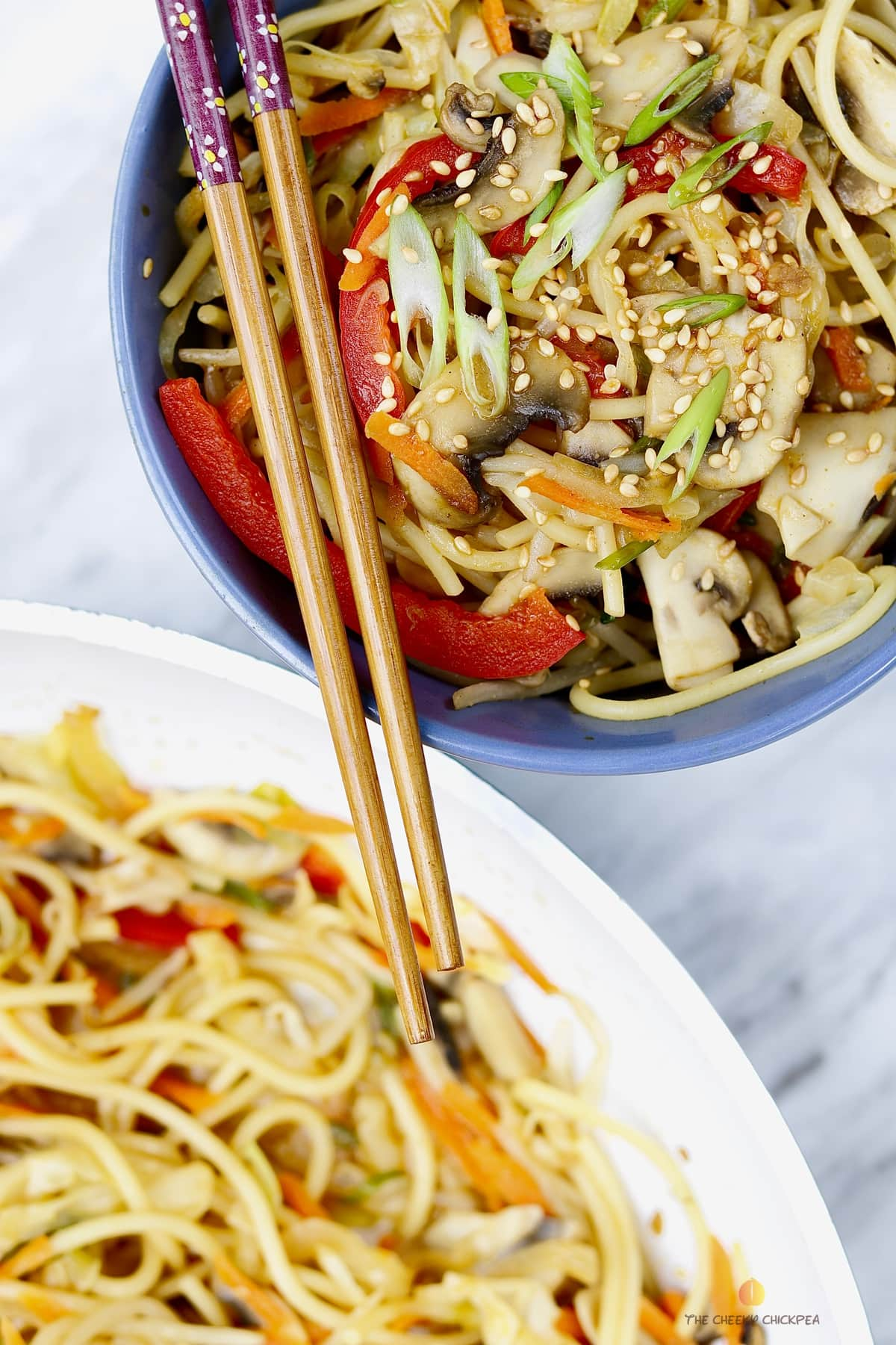 Veggie Chow Mein Recipe in blue bowl on marble countertop