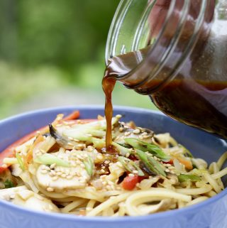 5 spice Stir-Fry sauce and noodles in blue bowl on marble countertop