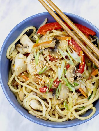 vegetable Chow Mein in blue bowl on marble countertop