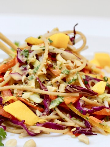 Ultimate Thai Noodle Salad with Lemon Ginger Dressing on white plate
