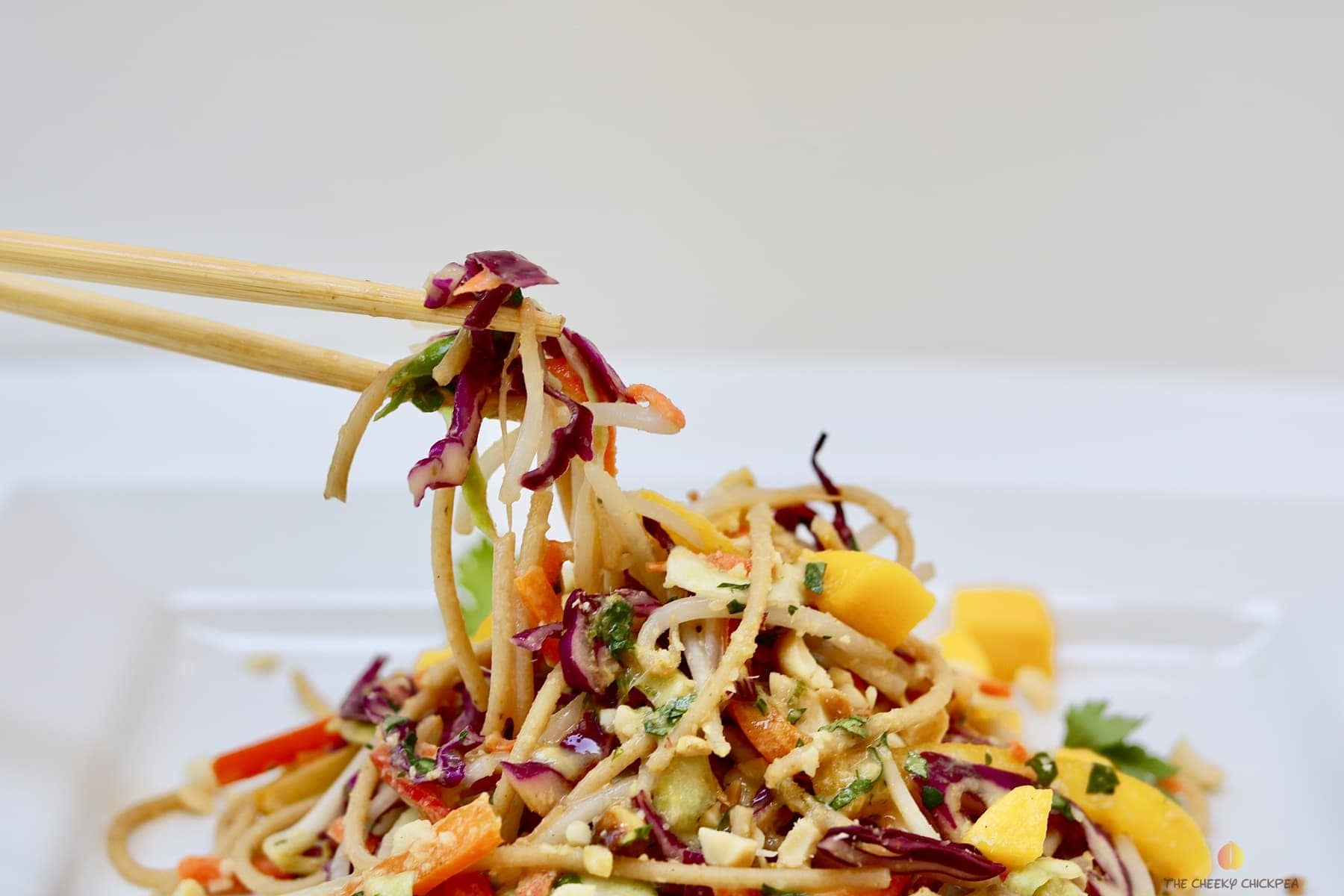 ultimate Thai noodle salad with lemon ginger dressing on a white plate