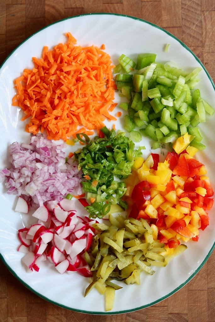 vegetables prepped for salad on a plate