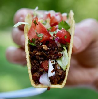 tasty tex mex vegan taco meat recipe held in the air