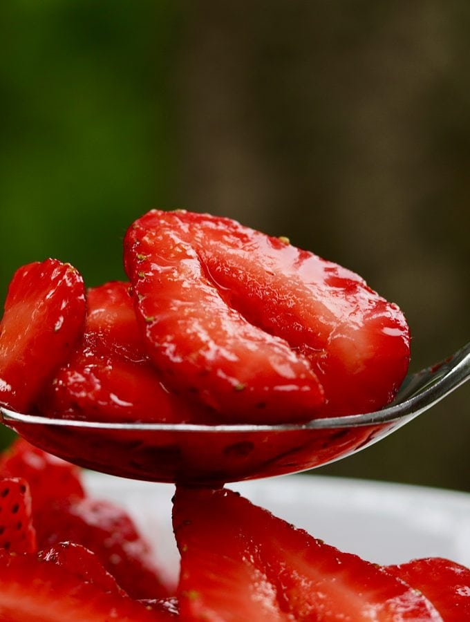 simple macerated strawberries recipe on a spoon