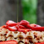 delicious everyday vegan waffles (gluten free option) on a white plate with strawberries