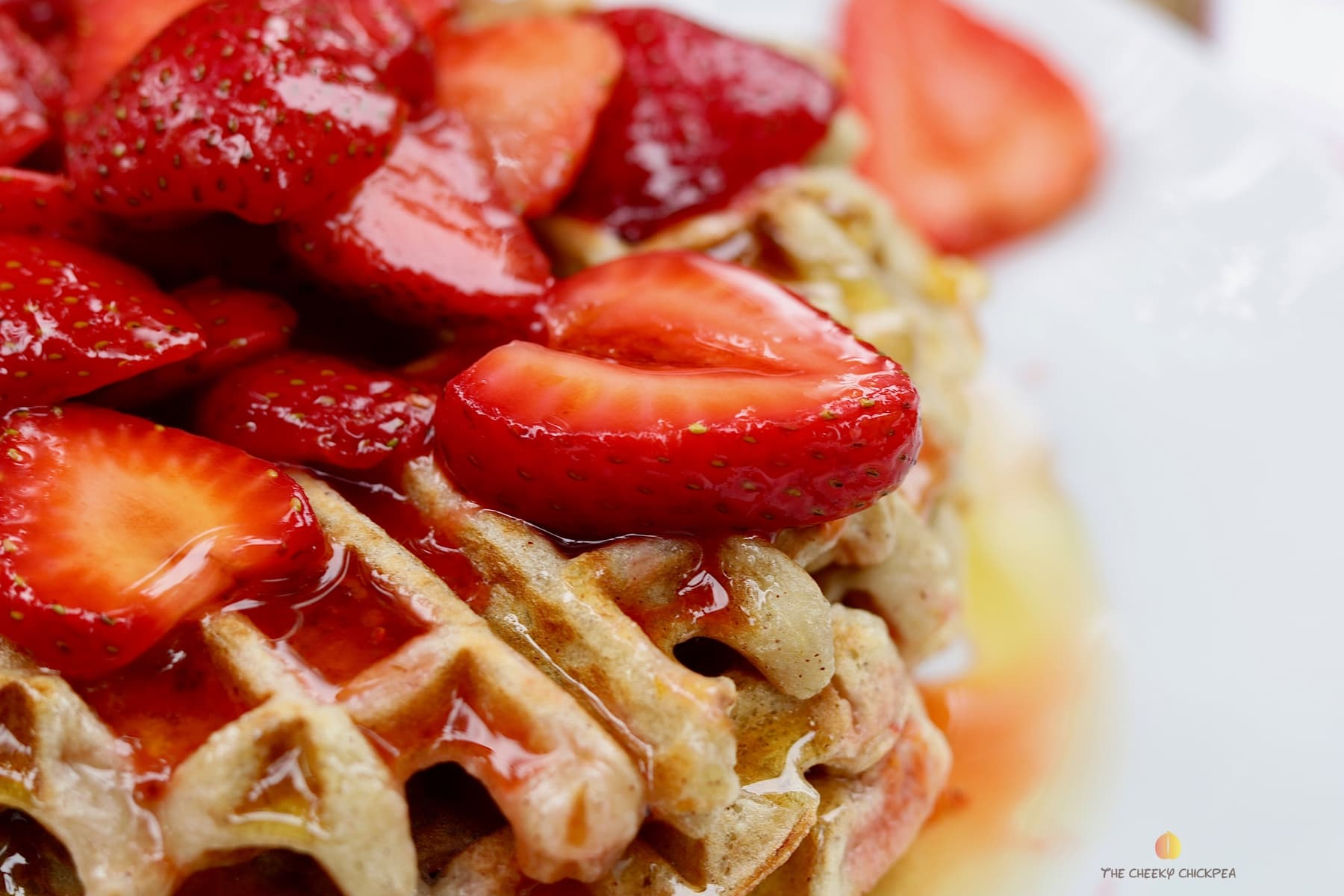 simple macerated strawberries recipe on top of waffles