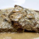 vegan salsbury steak meatloaf on a white plate