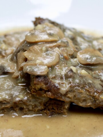 vegan salsbury steak meatloaf on a white plate
