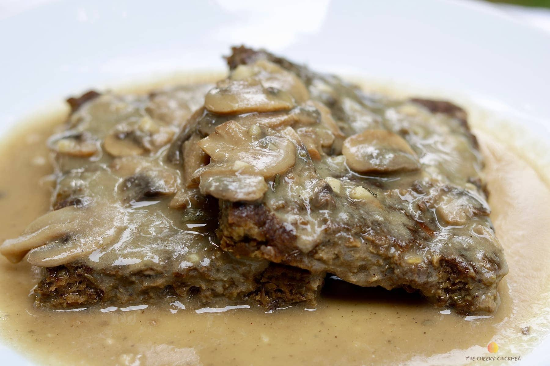 vegan salsbury steak recipe on a white plate