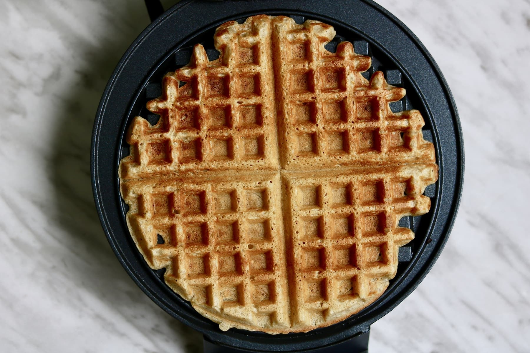 delicious everyday vegan waffles recipe (gluten free option) in a waffle iron