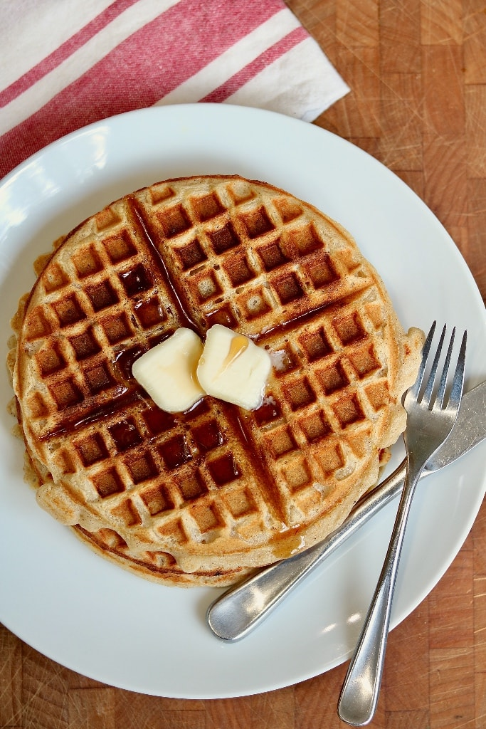 top view of vegan waffles on a white plate