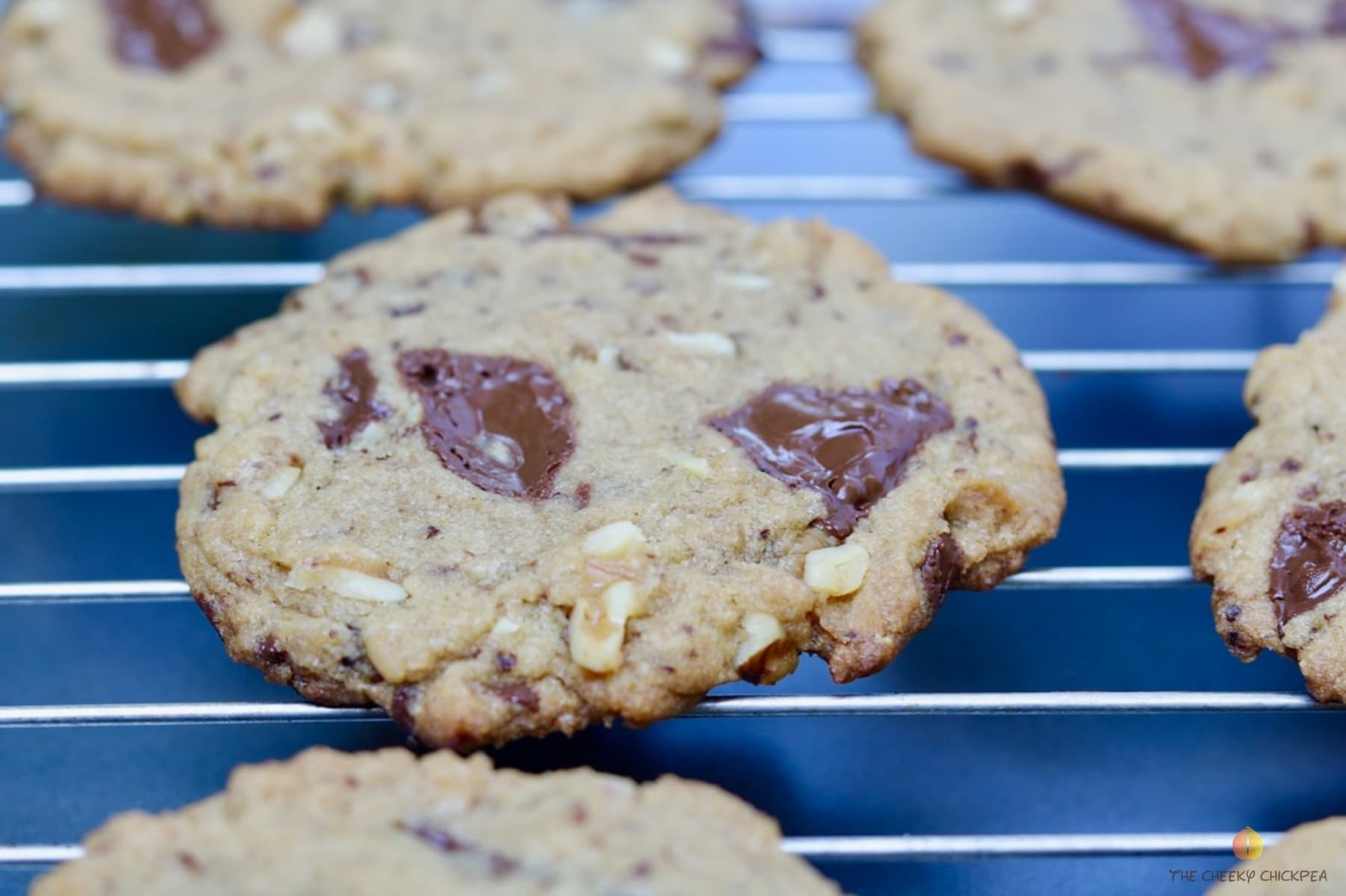 close up of vegan chocolate chip cookies on a cooling rack