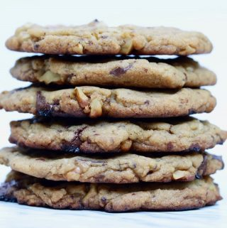 best vegan chocolate chip cookies stacked on a marble countertop
