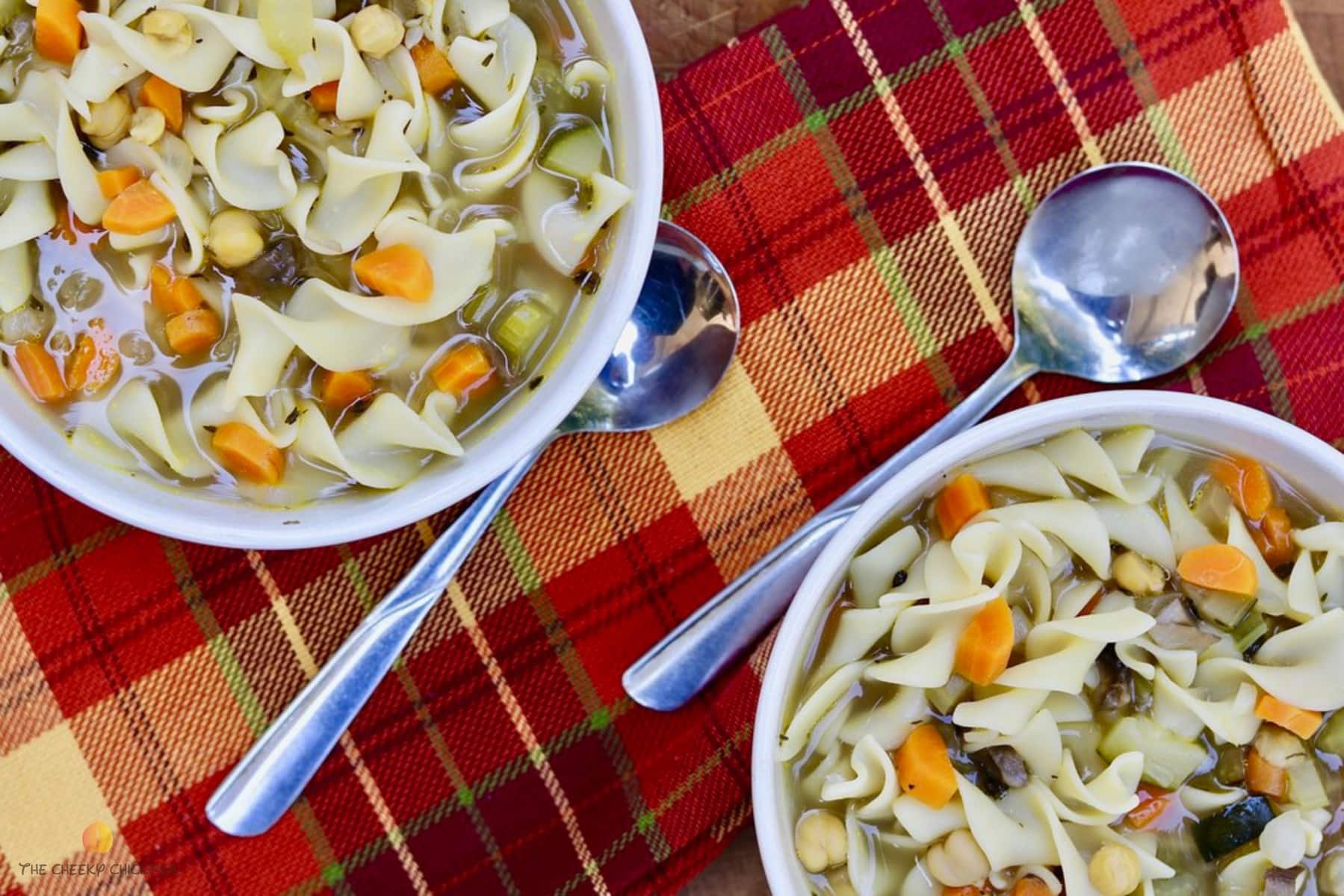 classic vegan chicken noodle soup in a white bowl