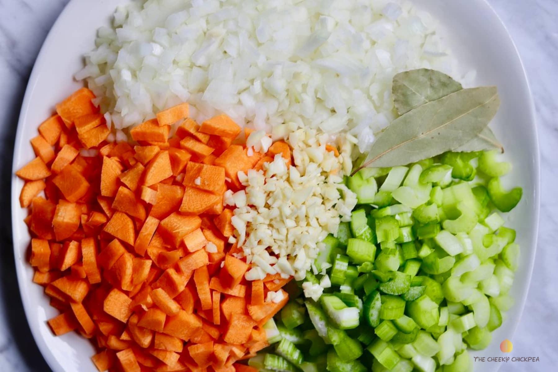 vegetarian split pea soup vegetables on a white plate