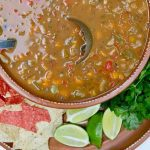 mexican bean soup in a brown bowl