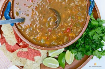 mexican bean and veggie soup in a brown bowl