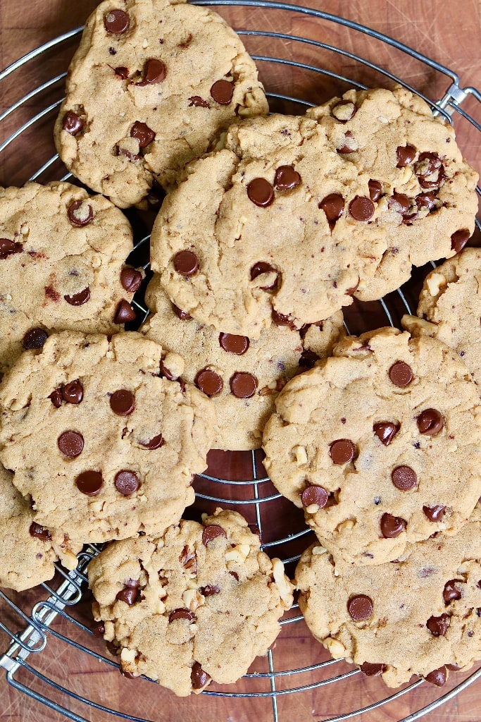 overhead view of baked vegan chocolate chip cookies on a cooling wrack