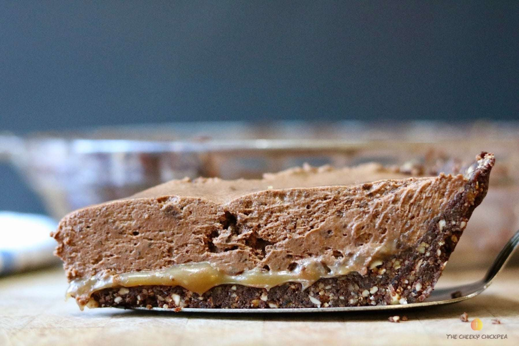 salted caramel vegan chocolate pie on a wooden cutting board