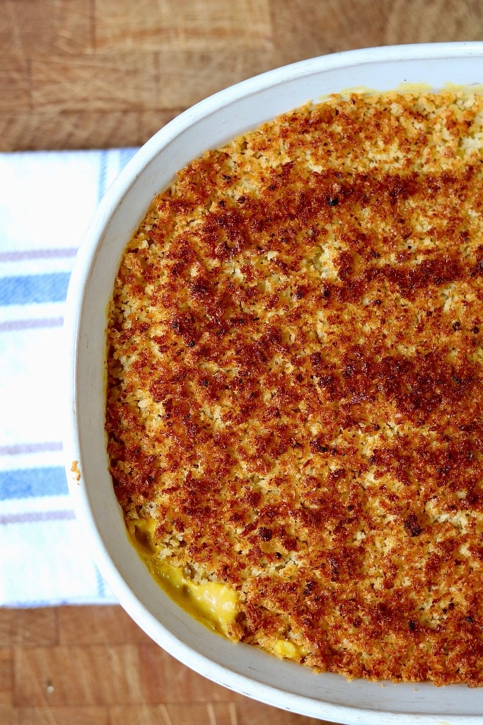 vegan mac and cheese baked in a casserole dish