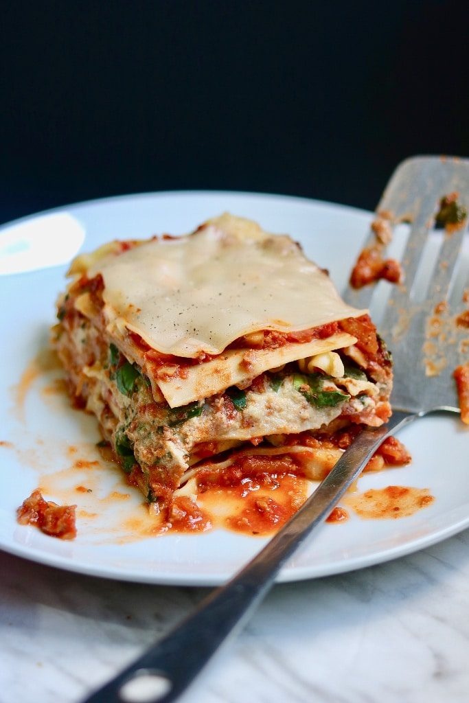 piece of vegan lasagna on a white plate