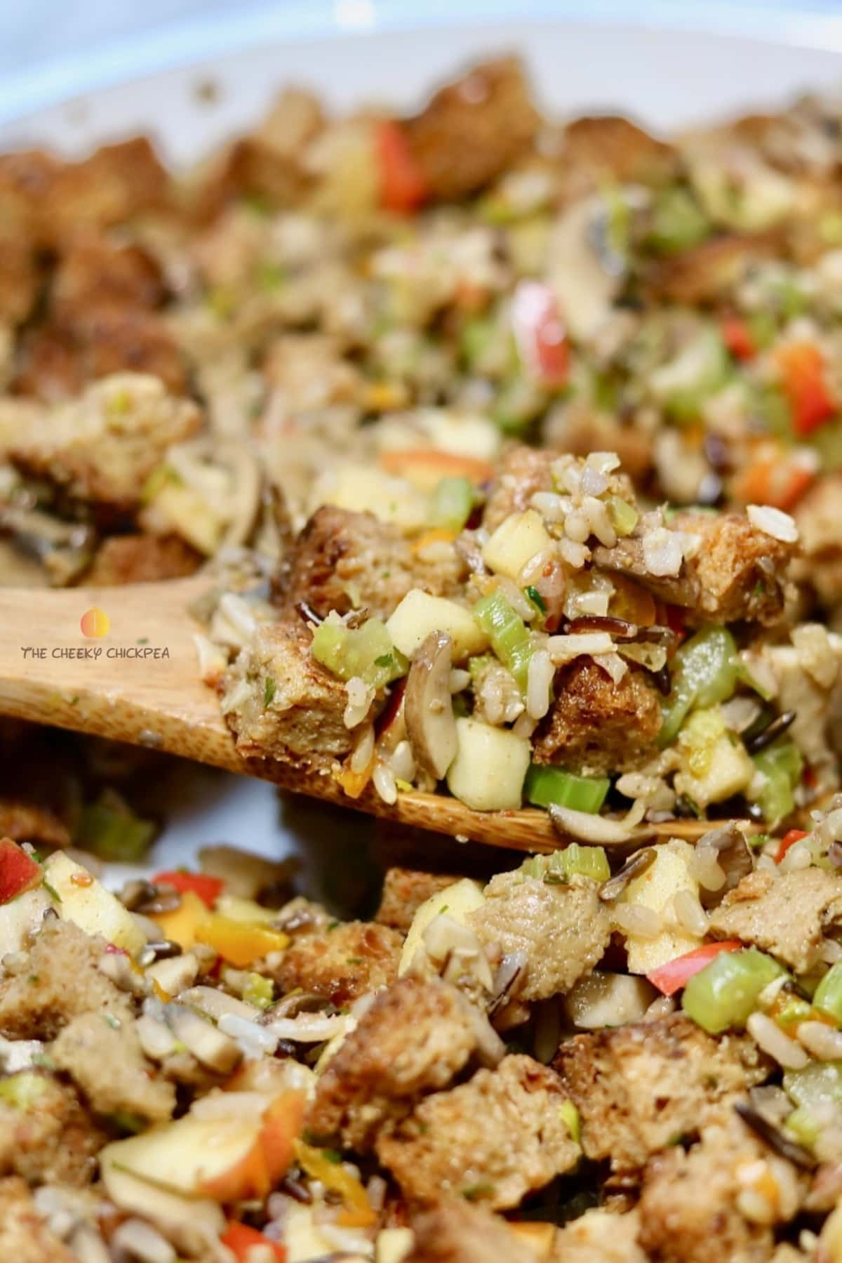 perfect vegan stuffing on a wooden spoon