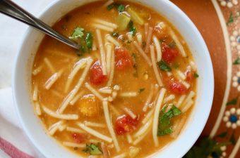 sopa de fideo in a white bowl