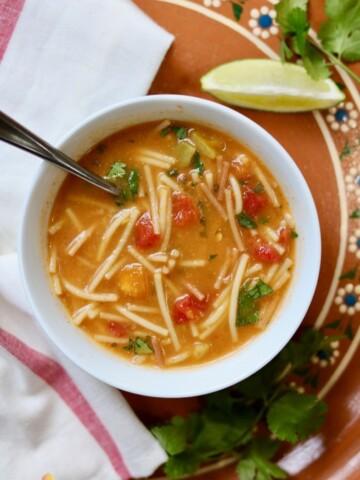 sopa de fideo (mexican noodle soup) in a white bowl