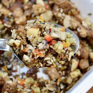 perfect vegan stuffing on a serving spoon