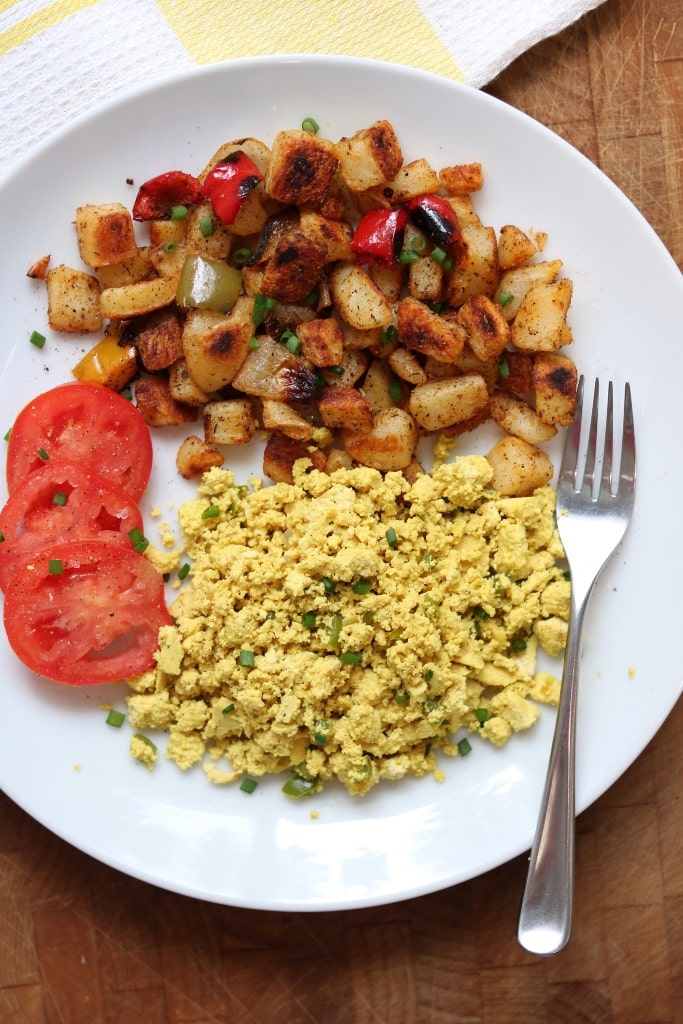 best home fries recipe on a white plate with tomatoes and potatoes