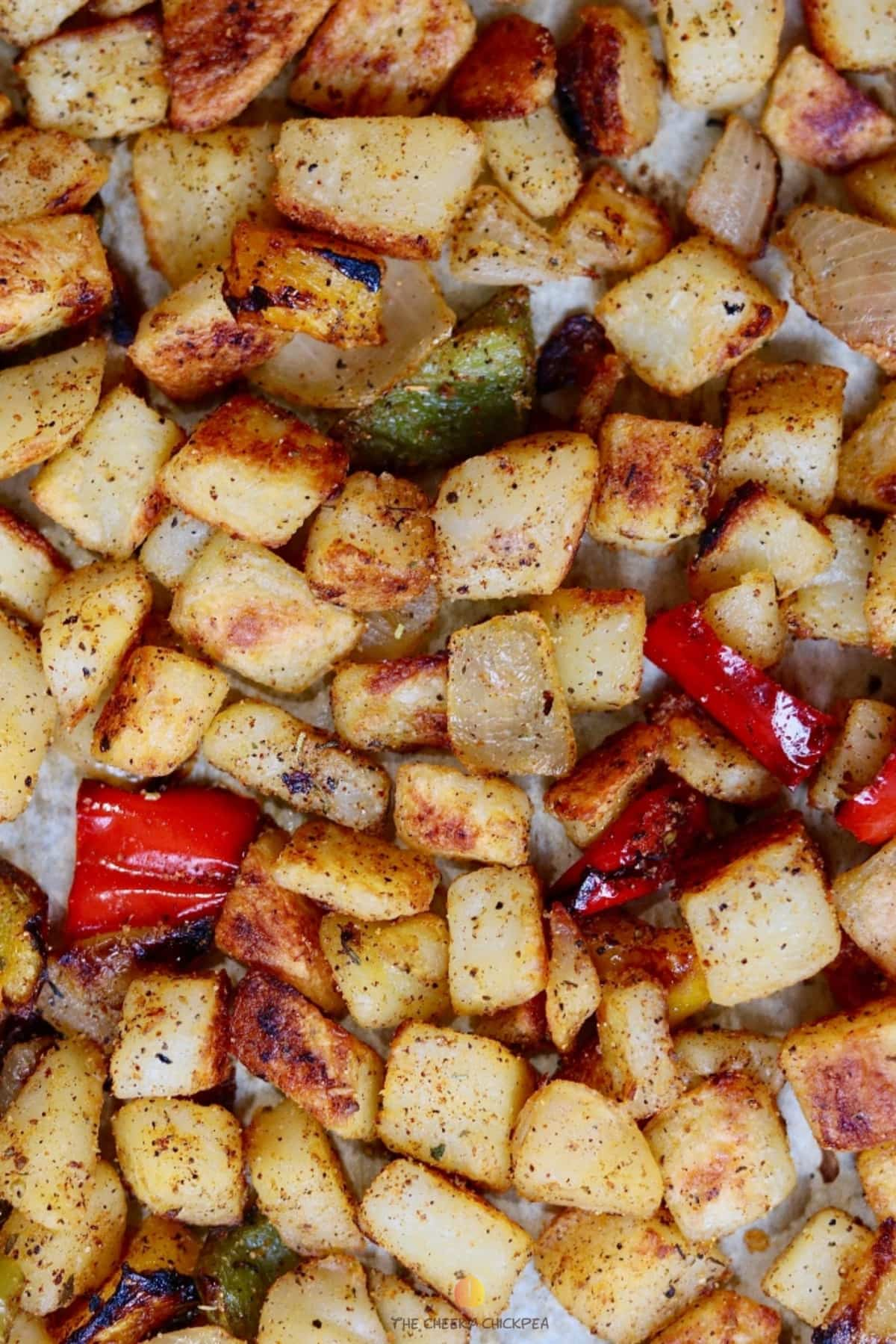 best home fries recipe on a baking sheet with peppers and onions