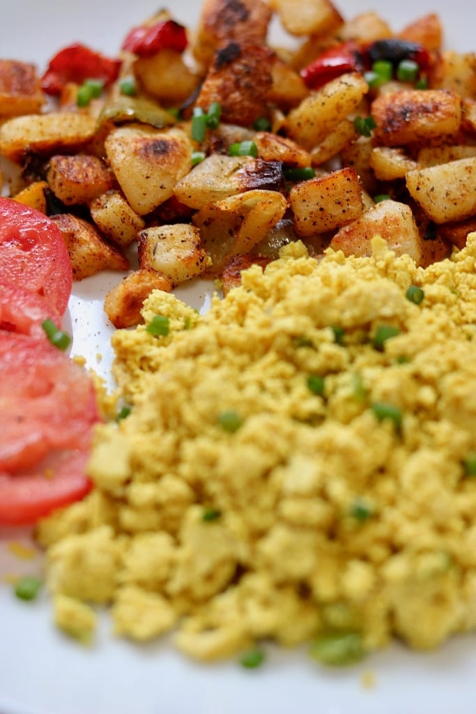 best home fries recipe on a white plate with tofu scrambled eggs and tomatoes