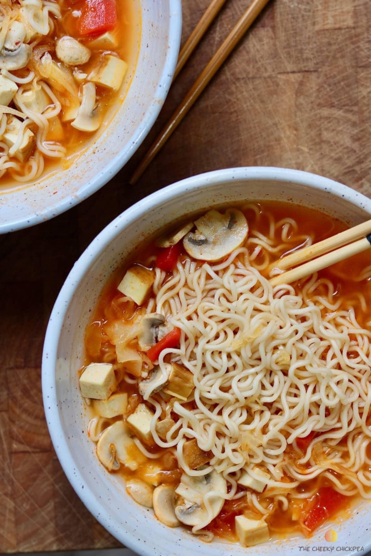 ramen noodle soup in a white bowl with chopsticks