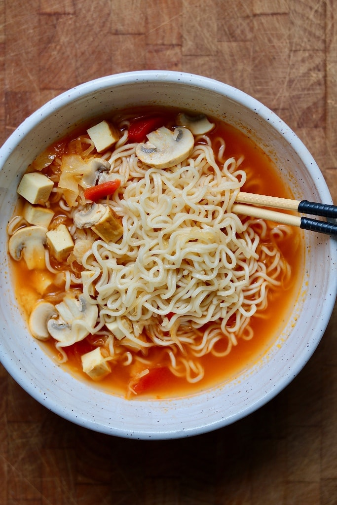 ramen noodle soup in a white bowl with chopsticks