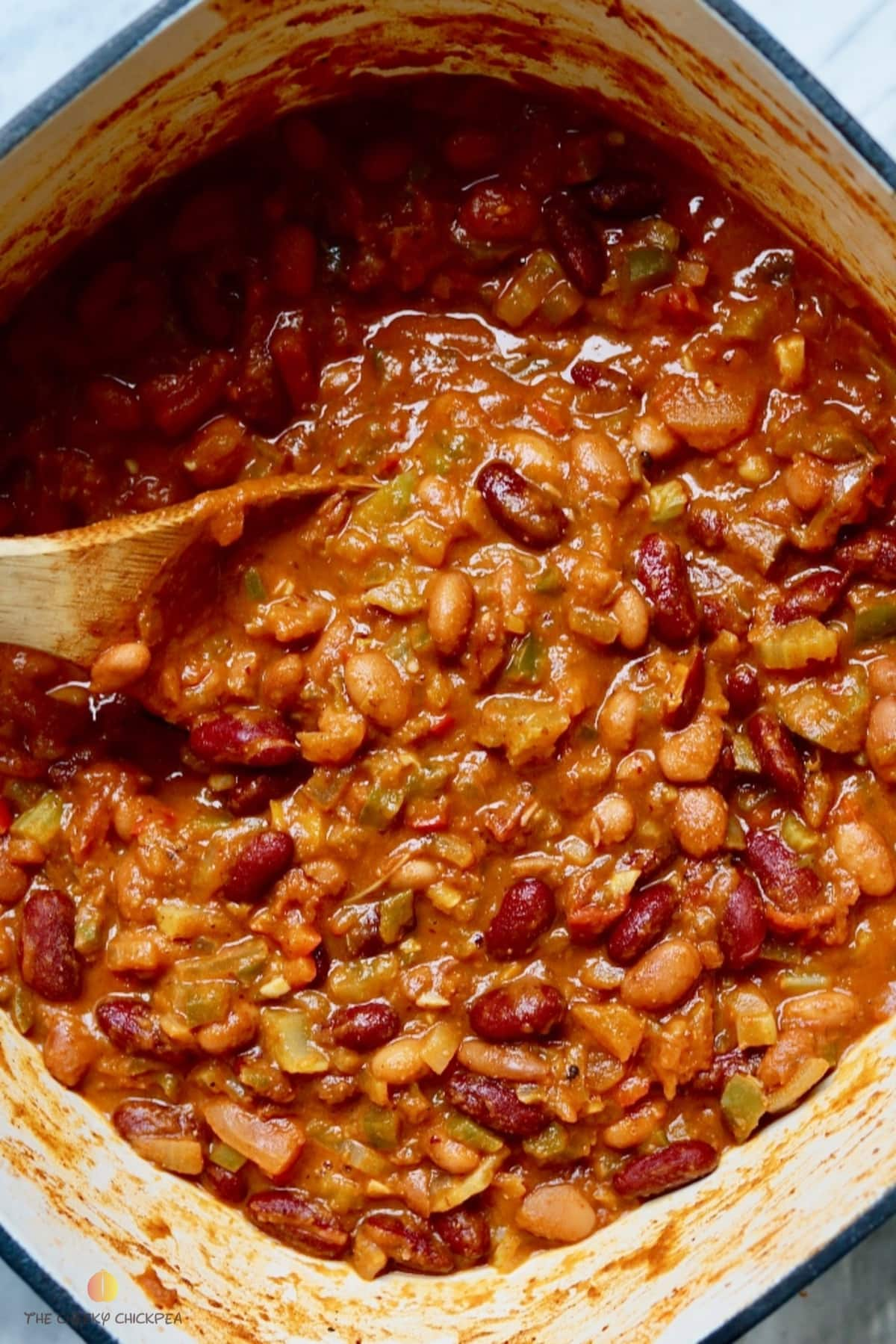 vegan Chili in a pot with a wooden spoon