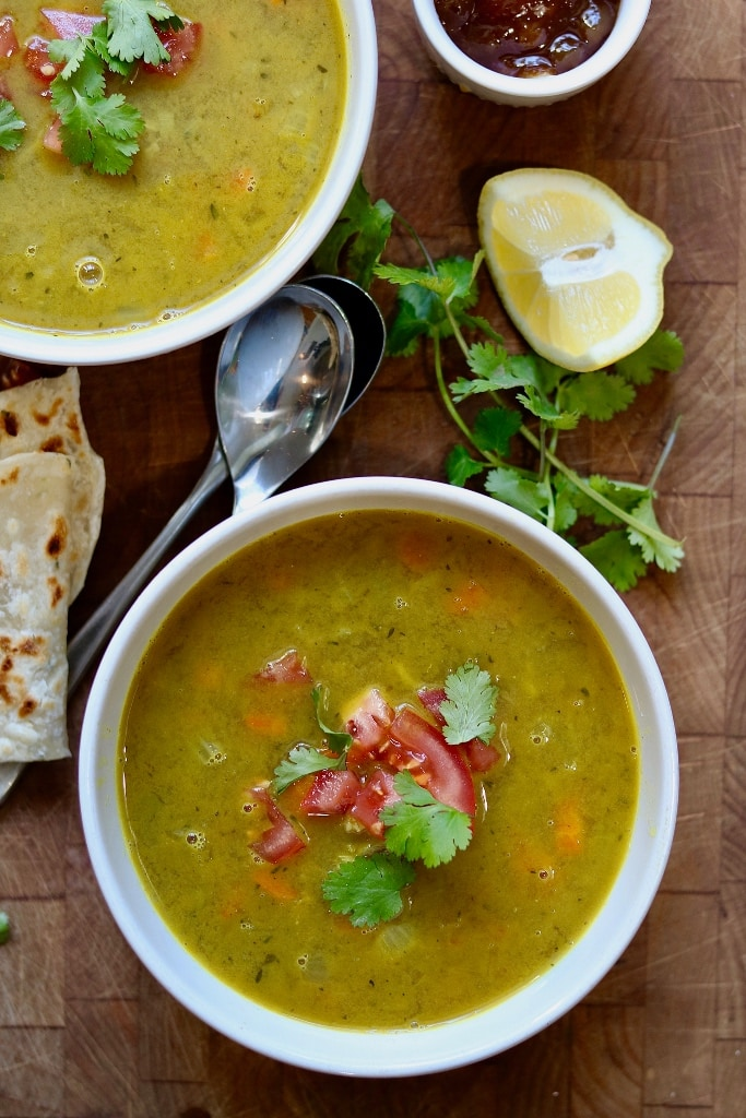mulligatawny soup in a white bowl on a wooden table