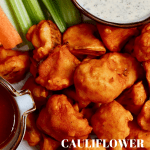 buffalo cauliflower wings served with veggies and vegan ranch dressing