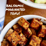 marinated tofu pieces in a white bowl