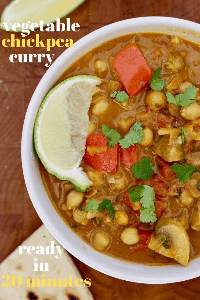 vegetable chickpea curry in a white bowl on a wooden countertop