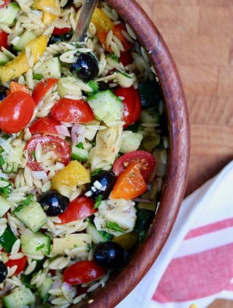 mediterranean orzo salad in a wooden bowl