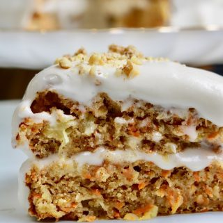 slice of vegan carrot cake on a white plate