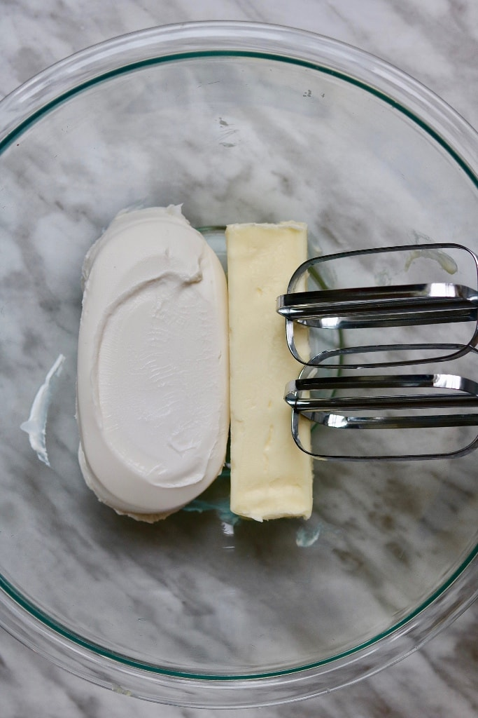 vegan cream cheese and vegan butter in a mixing bowl with beaters