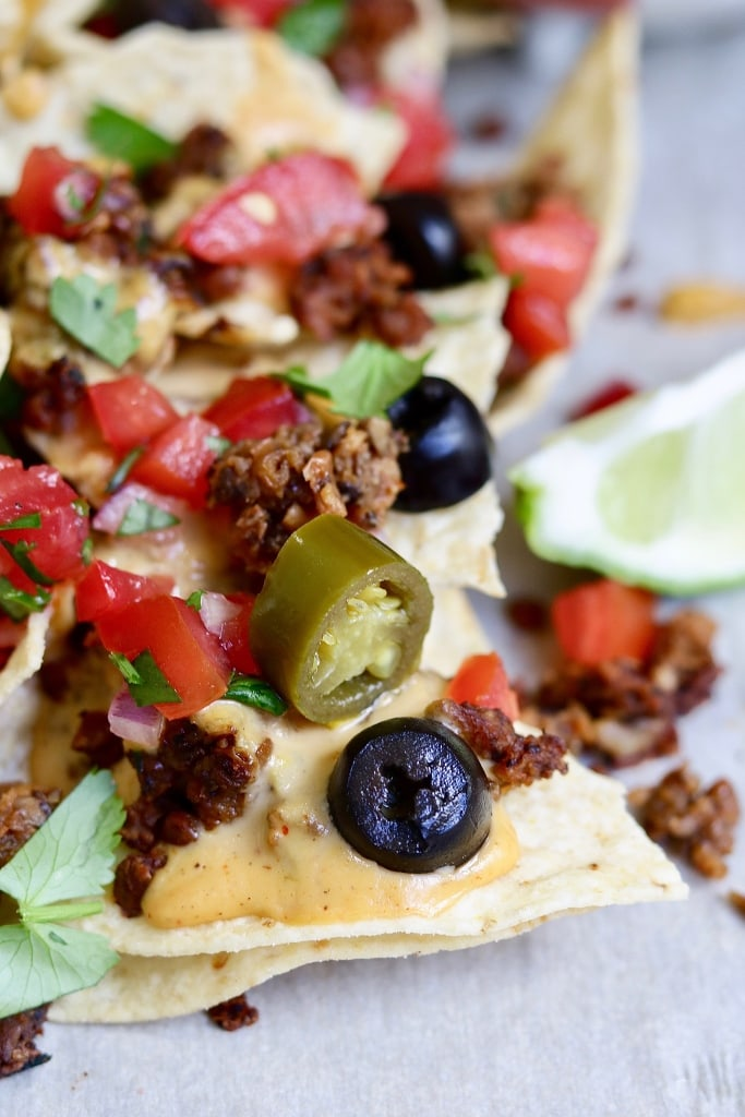 close up of vegan nachos on a baking tray