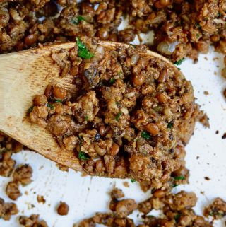 vegan taco meat on a wooden spoon