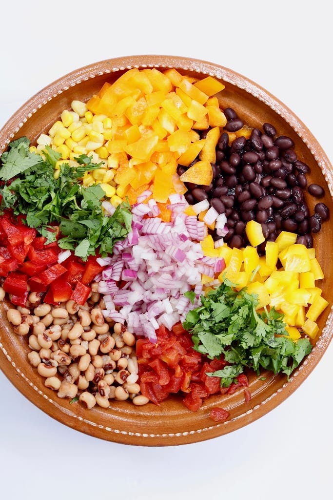 ingredients for cowboy caviar in a brown bowl