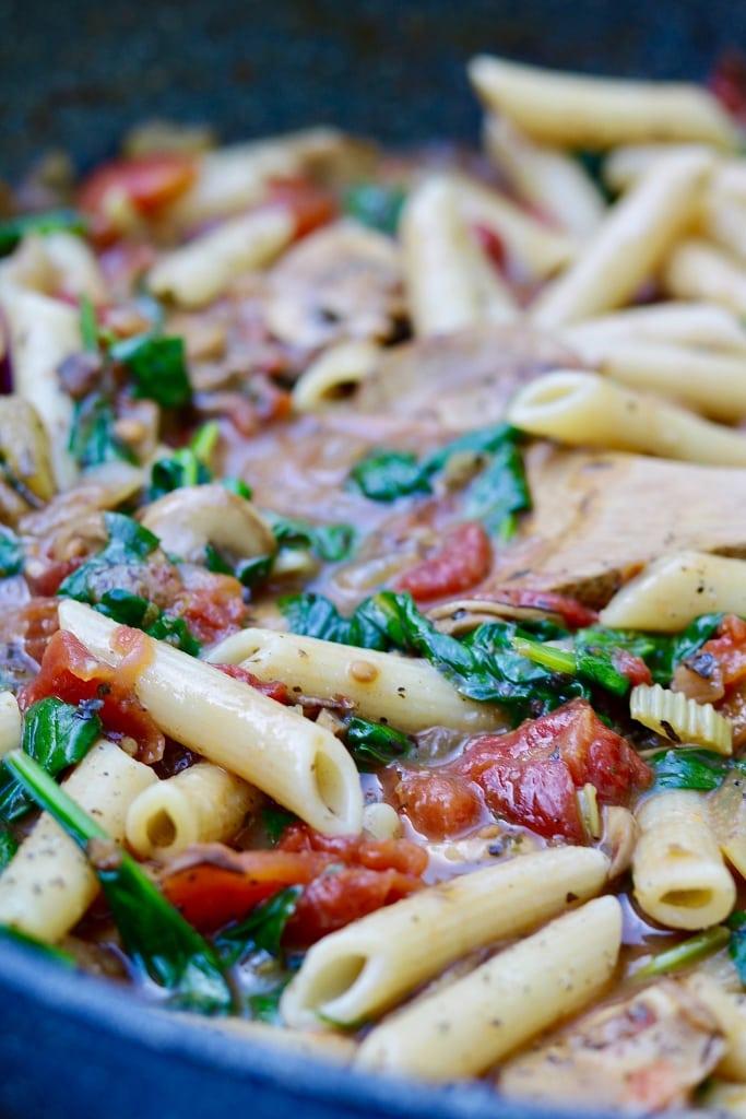spinach mushroom pasta in a skillet
