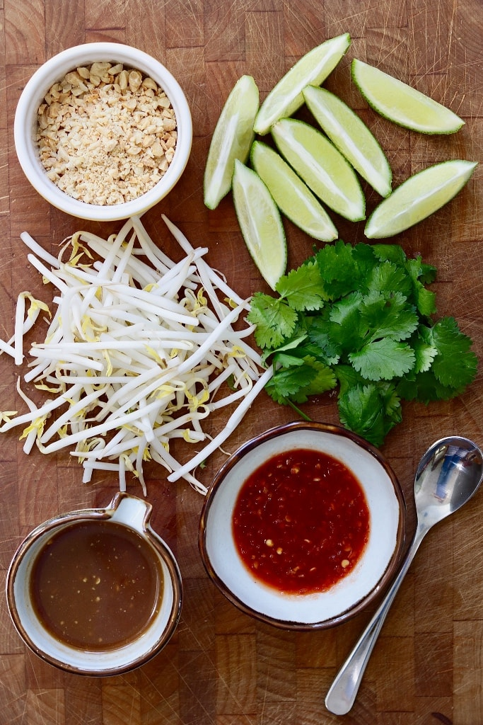 vegan Pad Thai toppings on a wooden cutting board