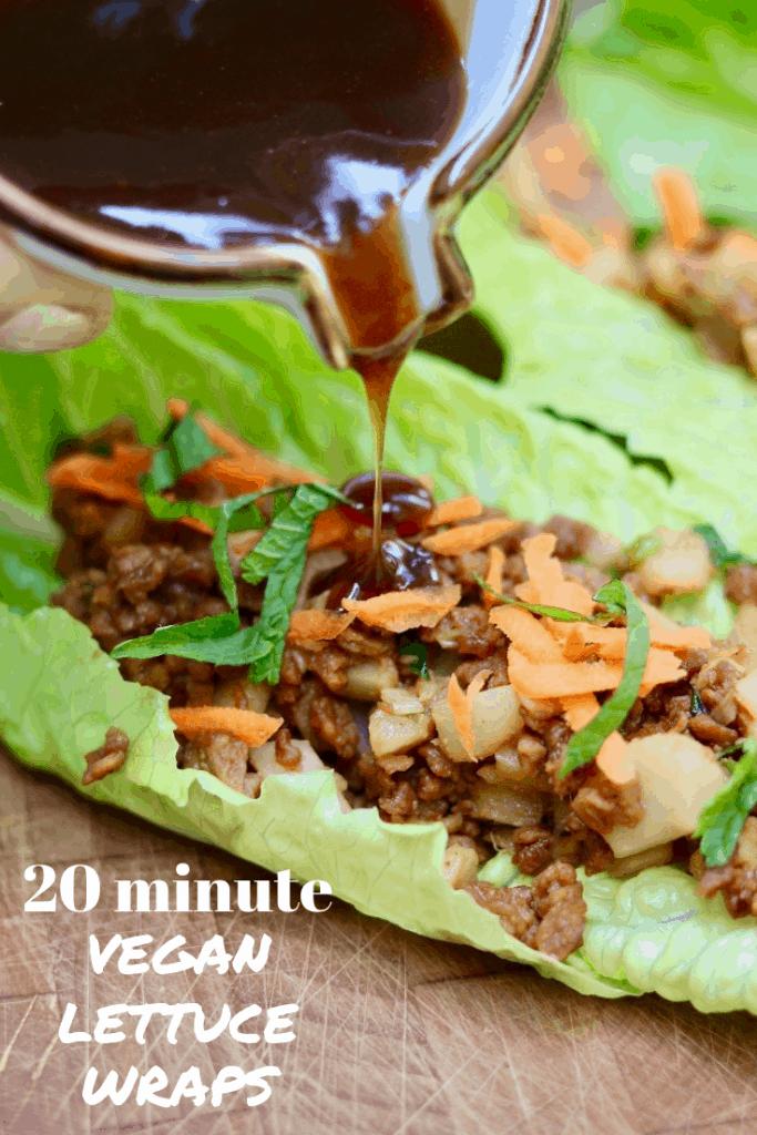 sesame hoisin sauce being poured on a vegetarian lettuce wrap